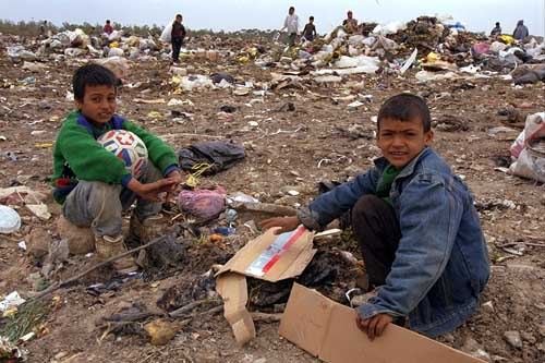 Gazan boys looking through trash for food
